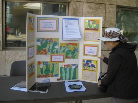 Kiki Scholosberg from Jefferson Elementary School displays beautiful works of art inspired by Van Gogh's painting Irises.