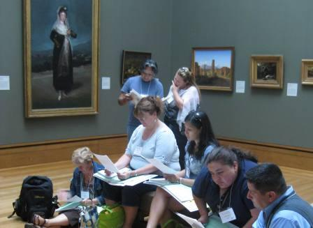 Fifth grade teachers gather in the galleries to learn how to engage students in discussions about art.