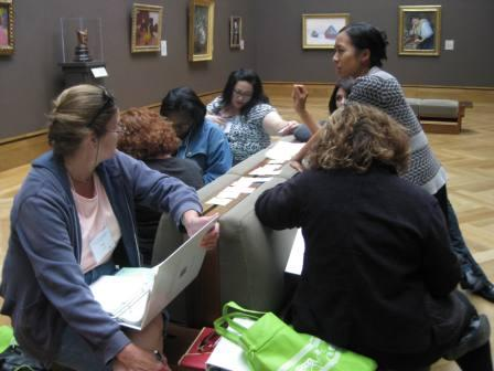 Museum educator Theresa Sotto explains a way to sequence discussion questions as teachers follow along in their handouts.