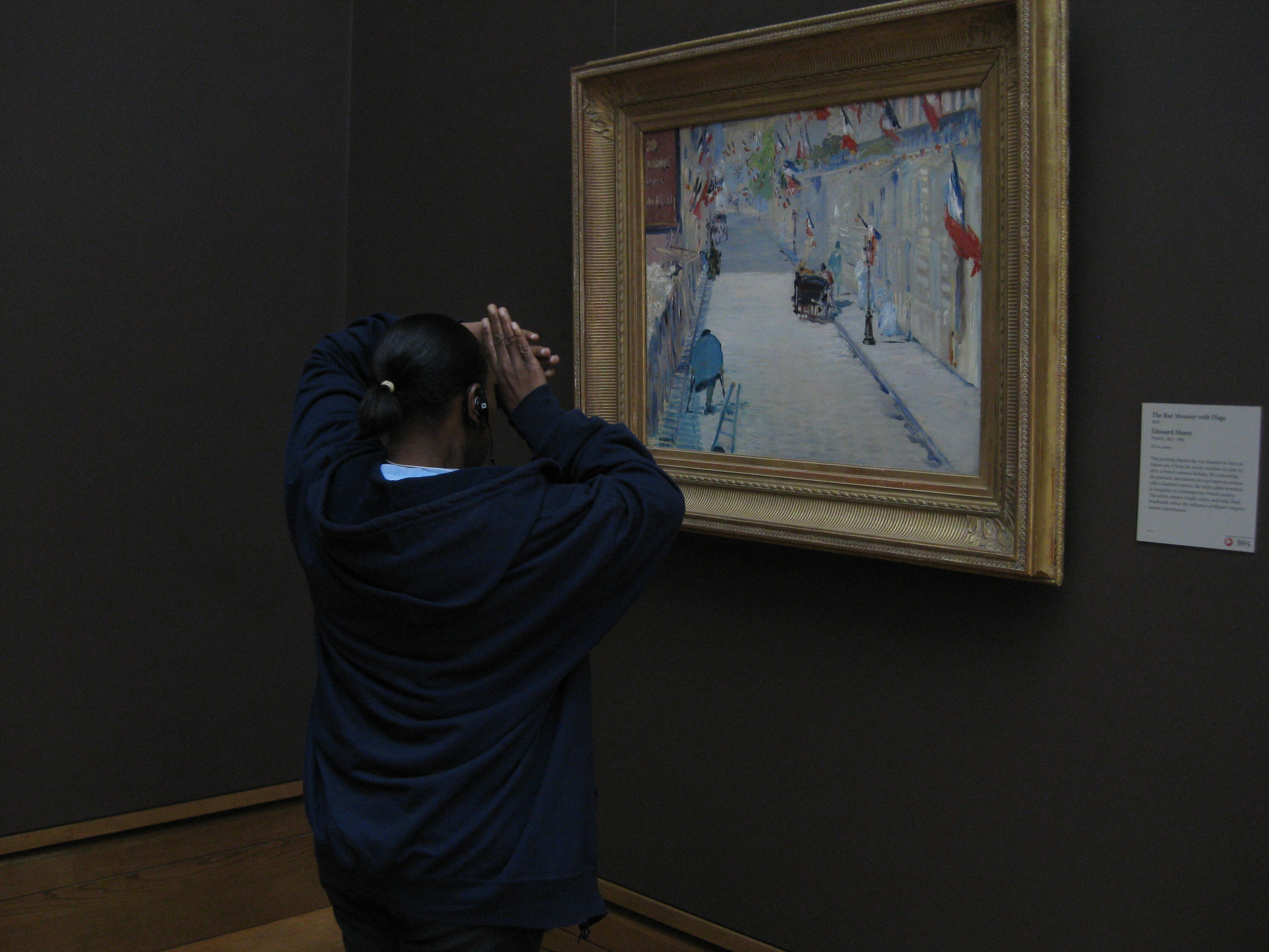 Using hands as a viewfinder, one teacher notices how a detail of Manet&#039;s painting was not created with just white paint alone, but several different colors.