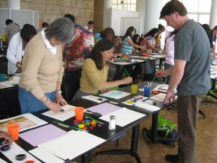 Participants explore different ways of making marks with a variety of brushes.