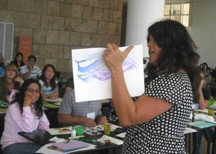 "Artist and educator Sandy Rodriguez leads a ""Painting on a Budget"" art-making activity."