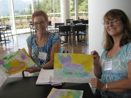 Teachers Marilyn Taylor Kremen and Lisa Heather pose proudly with their finished works of art.