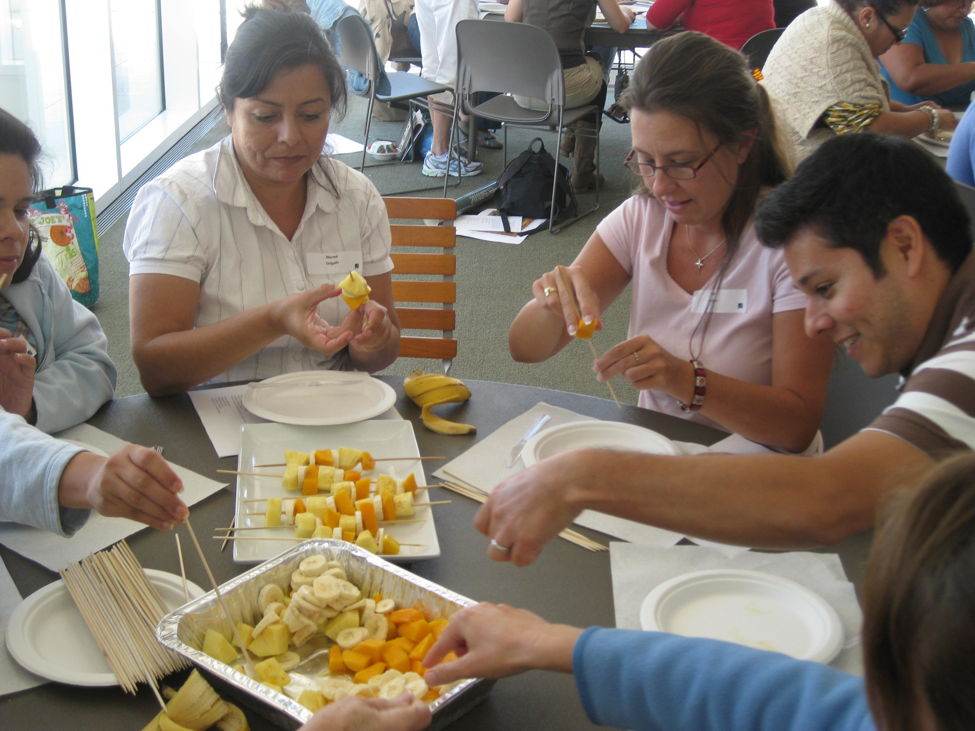 Teachers had a great time turning pineapple skewers into sculptural creations.