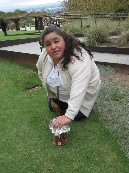 Teacher Marisela Reyes places her camera on the ground for an interesting angle.