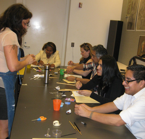 Teachers listen enthusiastically to artist and Getty staff member Sandy Rodriguez during a hands-on activity to bind a manuscript, make paint, and illuminate a manuscript page.