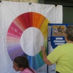 Van Deene E.S. teacher Barbara Heughins uses a colorful quilt made by her daughter to teach color lessons.