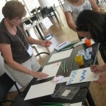 Teachers practiced created a variety of marks using different kinds of paints.