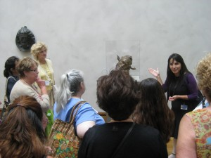Educator Veronica Alvarez tells a story about Midas, which inspired an artist to create his Self-Portrait as Midas.
