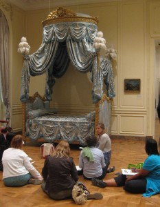 Educator Kelly Williams leads a writing activity inspired by an 18th century bed.