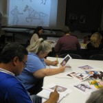 Teachers were fully immersed in the activity of drawing an animal by combining basic shapes.