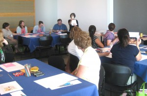Educator Flora Ito leads an activity on drawing...well, flora.