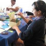Teachers added their own feathers, colored paper, and decorative designs to turn a cardboard box into a lavish bed.