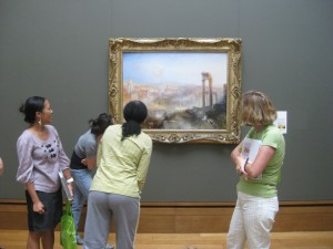 Third grade teachers look closely at one of our newest acquisitions, Joseph M.W. Turner's Modern Rome–Campo Vaccino.