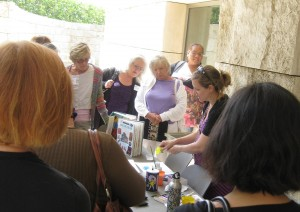 Museum educator Kelly WIlliams demonstrated how to use a toy squirt gun to create wacky watercolors.