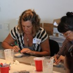 Teacher Moira Hanson was very focused on the task of creating an imaginative mold.