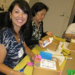 Teacher Nora Felix was all smiles during museum educator Sandy Rodriguez&#039;s clock-decorating workshop.