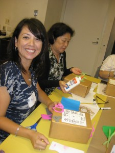 Teacher Nora Felix was all smiles during museum educator Sandy Rodriguez's clock-decorating workshop.