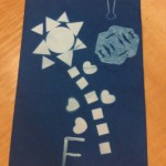 Teachers arranged shapes to create objects from nature, and then used those shapes and related text for their sun prints.