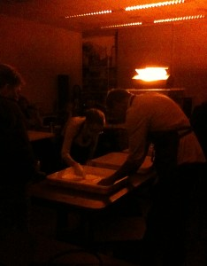 Teachers learn the process for developing prints&#151;the old school way.