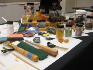 Artist Sylvana Barrett brought in an array of materials to demonstrate the pigments, tools, and techniques involved in making illuminated manuscripts.