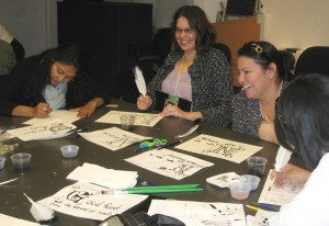 Teachers from Ellen Ochoa Learning Center have a blast illuminating their creative laws.