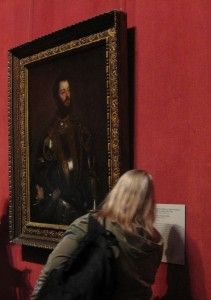 A teacher looks closely at the thin coats of paint applied by the artist Titian. Thankfully we can still see the thin layer centuries after the painting was made!