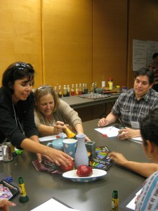 Teachers had fun arranging objects in preparation for their own still life collages.