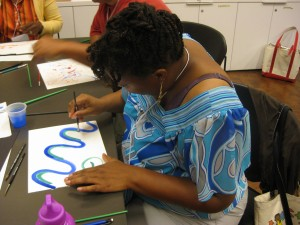Teachers learned how to paint on a budget by supplementing Alphacolor Biggie Cakes with paints made with kool-aid and coffee.