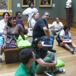Teachers spend time analyzing the clues in a painting.