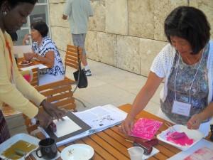 42nd Street Elementary School teachers Judy Matsumoto and Donna Massenburg are enjoying the printing process.