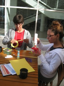 Teachers explore the array of interesting forms available from Trash for Teaching.