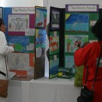Participants admire the colorful animal drawings of the students of Donna Massenburg and Judy Matsumoto at 42nd Street Elementary School.