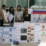 Teachers at Jaime Escalante Elementary School pose with the evidence of their hard work and achievements over the past year.