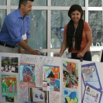 Noelia Moñarrez and Daniel Santoyo set up the displays for their lesson plans. Look at all that color!