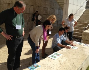 Teachers wait for their cyanotypes to be exposed to the sun.
