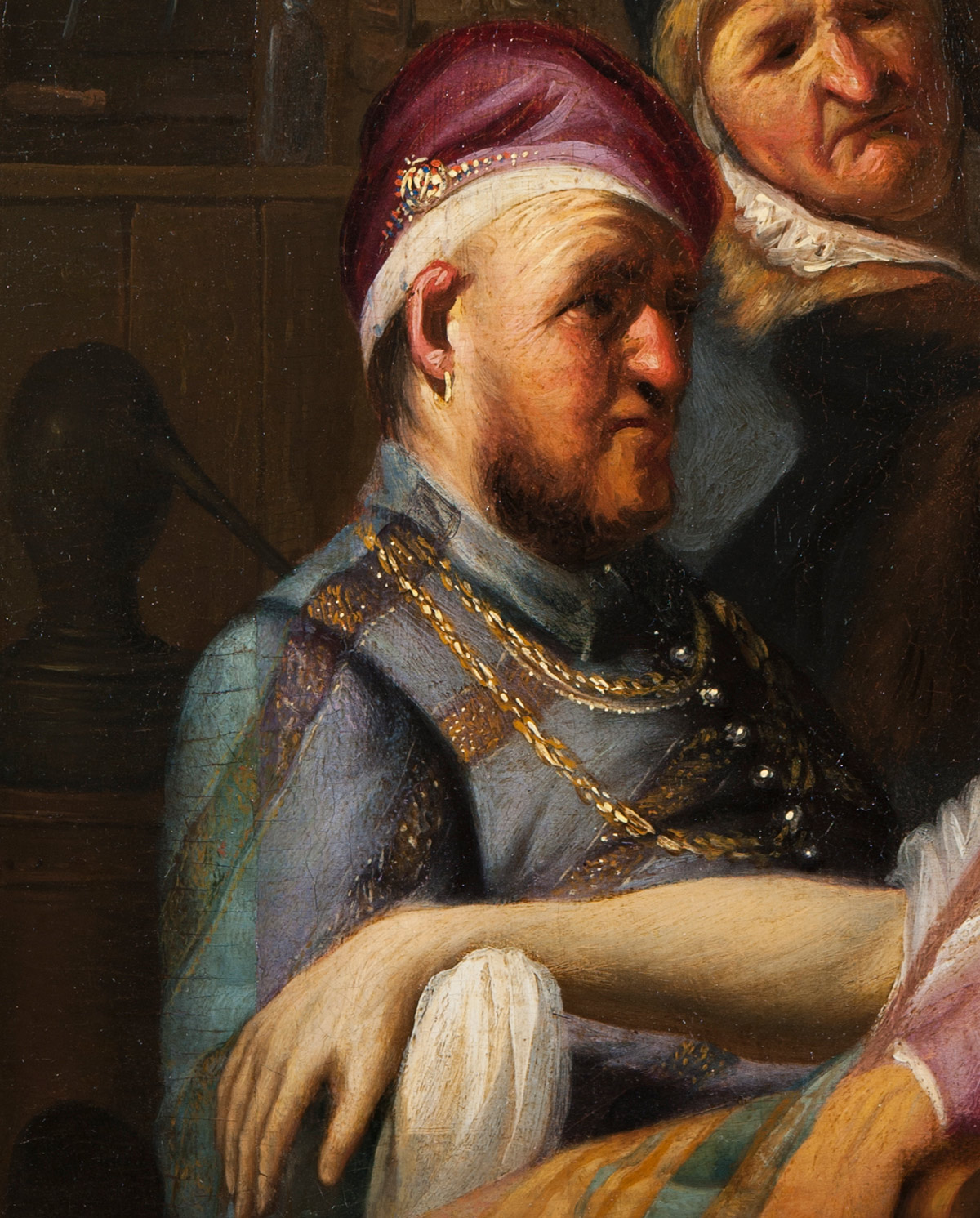 Detail of Rembrandt's Smell showing a figure's striped blue jacket
