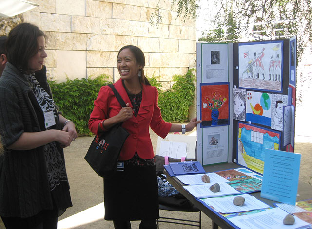 Discussing student artwork at the Art and Language Arts Culminating Event on April 24, 2010