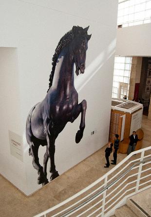 Wall mural (photograph by Ramak Fazel) of Nina Akamu's 24-foot-tall bronze sculpture Il Cavallo, made in homage to Leonardo da Vinci's plans for the Sforza horse