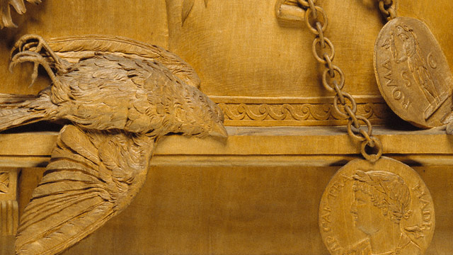 Carved Relief / Parent - detail of dead bird and medallions
