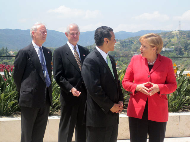 Thomas Gaehtgens, Jim Wood, Antonio Villaraigosa, and Angela Merkel outside the entrance to the Getty Research Institute