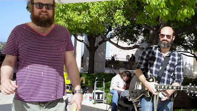 Sound check in the sun: Tim Harrington and Andrew Reuland of Les Savy Fav