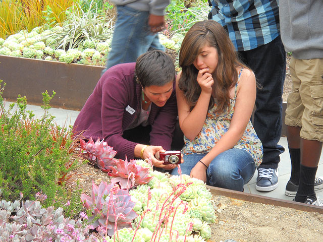 826LA volunteer Bristol Baughan and Westchester student Vivian Gaitan take practice shots in the Getty Center's Central Garden