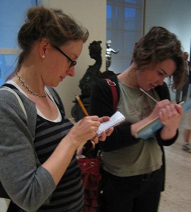 Kellian Adams and Phillippa Pitts writing clues for the SCVNGR hunt in the Getty Center's North Pavilion
