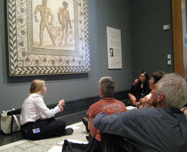 Gallery teacher Amber Wells leads a discussion in the Athletes and Competition gallery at the Getty Villa.
