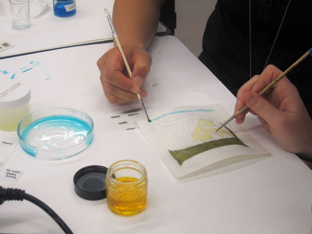 Students paint on parchment using saffron and other pigments mixed with glair as the binder