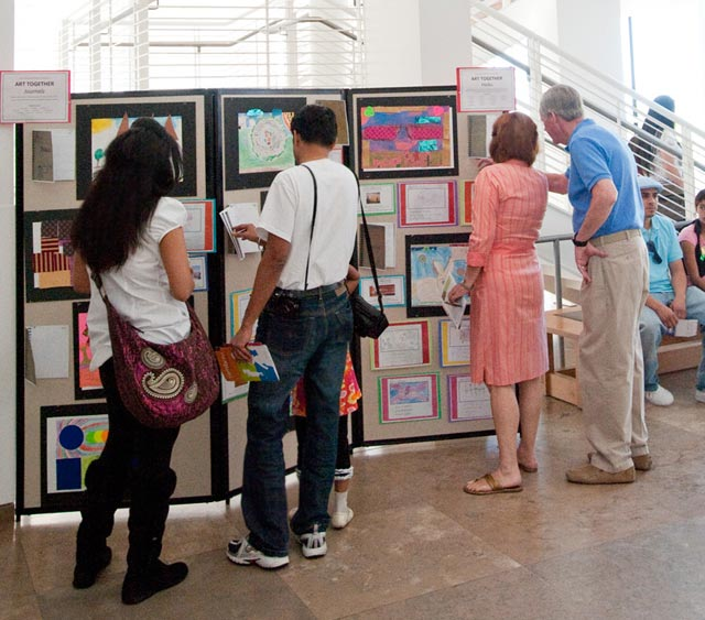 Families admire their students' artwork and writing inspired by their visits to the Getty Museum; at top, parents take a tour with students and Getty educators.