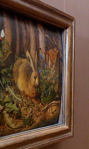 Hans Hoffmann's A Hare in the Forest is curved because its wooden support has warped with time.