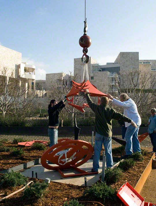 Bruce Metro (at right) installing <em>Gandydancer's Dream</em> by Mark di Suvero at the Getty Center