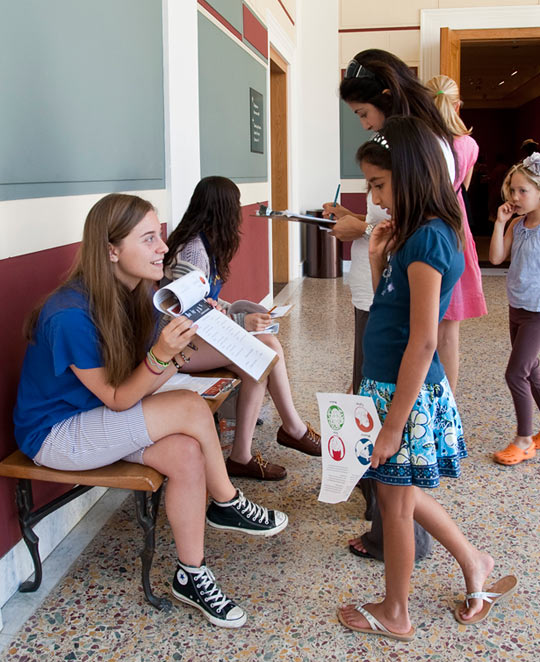 Villa Teen Apprentices working with young visitors in the Inner Peristyle at the Getty Villa